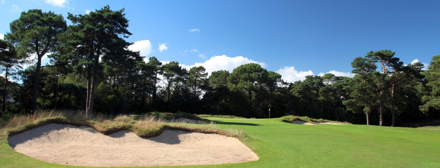 Looking down towards the green from behind a fairway bunker on the 10th
